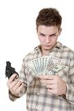 Money and gun. Young man with gun and money isolated on white Royalty Free Stock Image