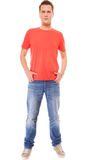 Young man guy red t-shirt jaens with hands in pockets isolated Stock Images
