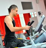 Young man in the gym Royalty Free Stock Images