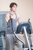 Young man at the gym exercising. Running Royalty Free Stock Photography