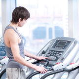 Young man at the gym exercising. Running Royalty Free Stock Images