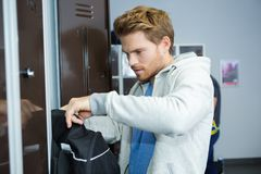 Young man in gym locker room Stock Photography