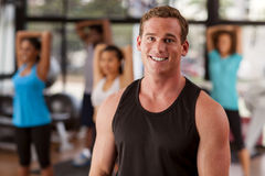 Young man in a gym. Young men in a gym preparing to exercise Stock Photography
