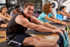 Young man in a gym royalty free stock photography