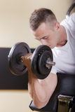 Young man in the gym Royalty Free Stock Photography