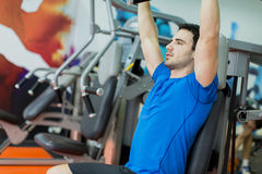 Young man in the gym. Young man training in the gym Stock Images