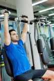 Young man in the gym Royalty Free Stock Image