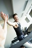 Young man in the gym Royalty Free Stock Photos