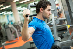 Young man in the gym Stock Image