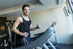Young man in the gym Stock Images