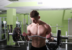 The young man in the gym Royalty Free Stock Photos