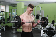 The young man in the gym Royalty Free Stock Images