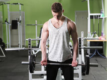 The young man in the gym Stock Image