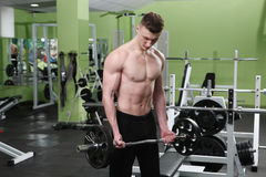 The young man in the gym Stock Photos