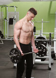 The young man in the gym Stock Photography