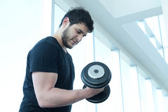 Young man at the gym Stock Images