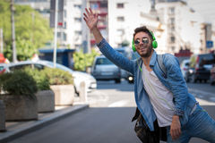 Young Man Hailing a Taxi . Royalty Free Stock Photography
