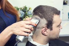 Young man at the hairdresser Stock Photography
