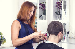Young man at the hairdresser Royalty Free Stock Images