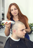 Young man at the hairdresser Stock Photos