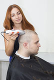 Young man at the hairdresser Royalty Free Stock Photos