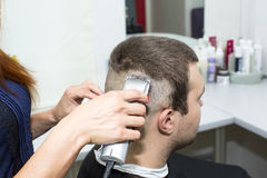 Young man at the hairdresser Royalty Free Stock Photography