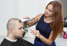 Young man at the hairdresser Stock Images