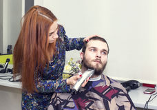 Young man at the hairdresser Stock Photo