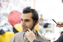 Young man at hairdresser Royalty Free Stock Photos