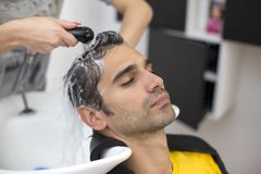 Young man at hairdresser Royalty Free Stock Photography