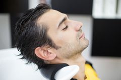 Young man at hairdresser Stock Photos