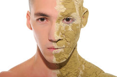 Young man half smeared with clay Stock Photos