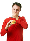 Young man with hamburger Stock Photography