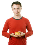 Young man with hamburger Royalty Free Stock Images