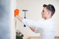 Young man with Hammer Stock Photography