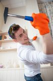 Young man with Hammer Royalty Free Stock Image