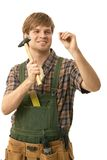 Young man hammering nail Royalty Free Stock Photos