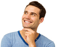 Young Man With Hand On Chin Looking Up Stock Image