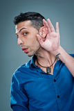Young Man with a Hand in the Ear Stock Images