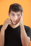 Young Man with Hand on Face Stock Photos