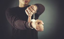 Man hand handcuffs royalty free stock photography