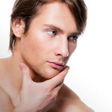 Young man with hand near the face. Royalty Free Stock Images