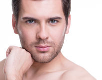 Young man with hand near the face. Royalty Free Stock Photo
