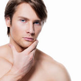 Young man with hand near the face. Royalty Free Stock Image