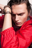 Young man with hand near his face and closed eyes Stock Image