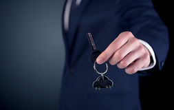 Young man hand over keys Royalty Free Stock Image