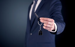 Young man hand over keys Stock Photos
