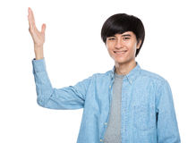 Young man with hand presentation Royalty Free Stock Photos