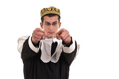 Young man with handcuffs costumed in nun for fun, funny religiou Stock Image