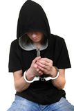 Young Man in Handcuffs. Isolated on the White Background Royalty Free Stock Photography